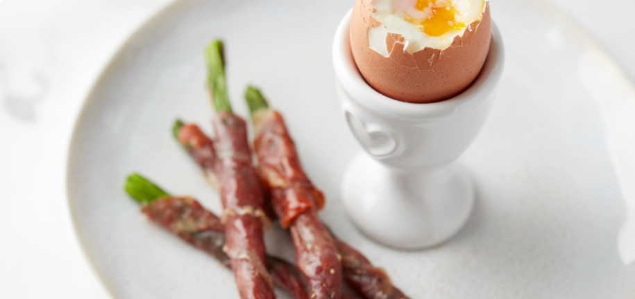 Boiled Eggs with Crispy Asparagus and Parma Ham Soldiers